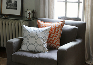 White and Orange Throw Pillows